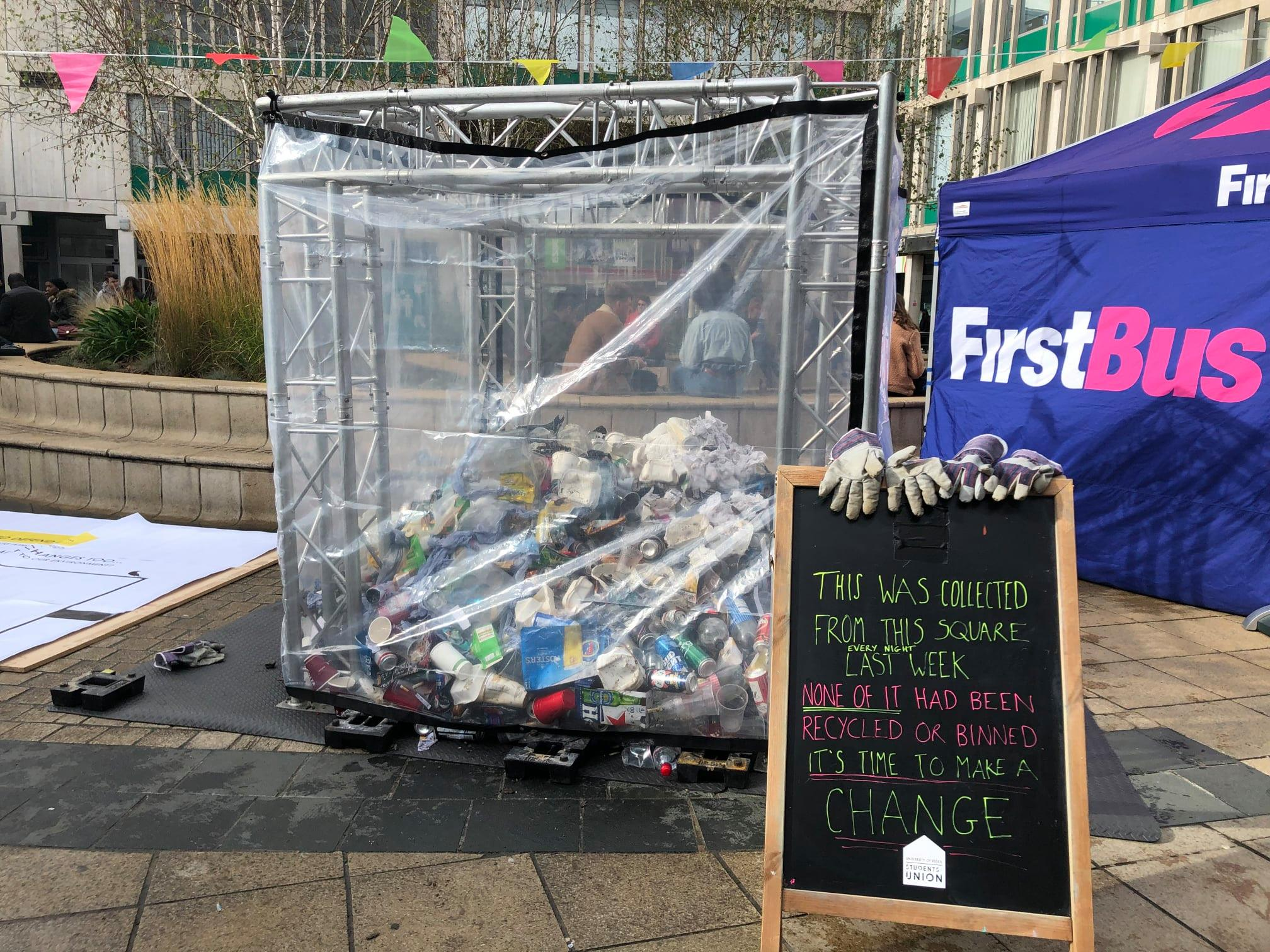Image of the rubbish mountain, a large square cage half full of litter