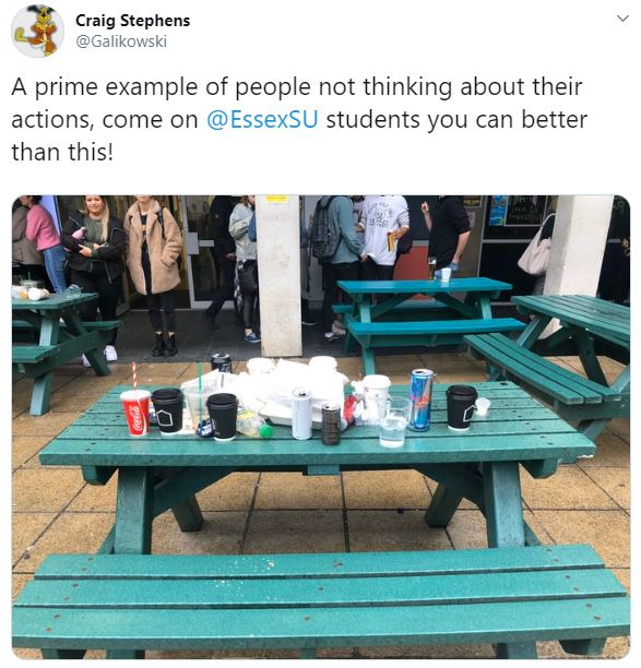 a screenshot of an tweet with an image of a whole table of litter outside of the SU Bar